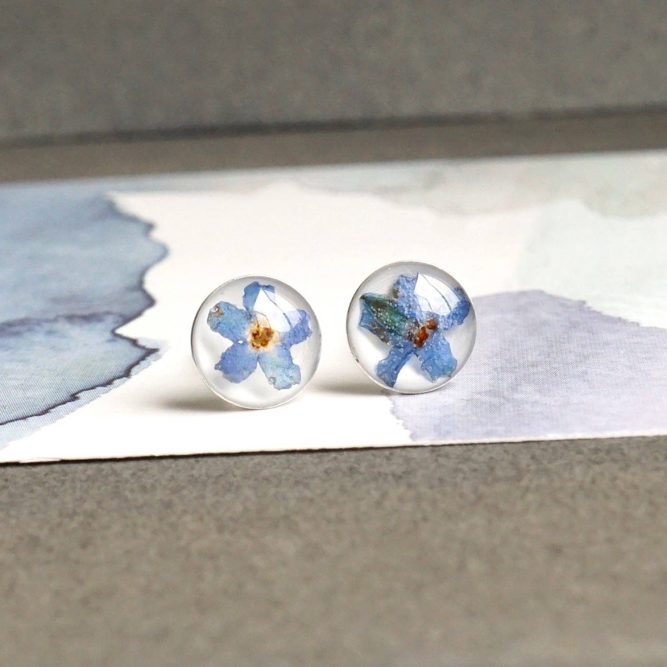 6805c0a06 Unique Pebs jewelry, sterling silver earrings with real Myosotis sylvatica  blue flowers preserved in resin, on a white background. Designed by adela  cremene ...